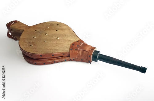 Fotografía Natural wood and leather bellows for fireplaces and barbarcoas isolated on white background