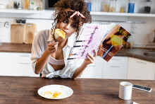 Curly Woman Eating Fried Eggs ...