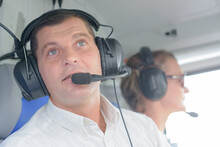 Helicopter Pilot In The Cabin During The Flight