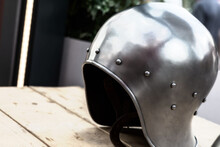 Iron Forged And Light Helmet For Infantry Close-up Stands On The Table