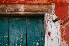 Brightly Colored Worn Paint On A Door In Venice, Italy