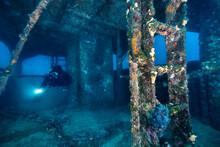 Scuba Diver Exploring The Hull Of A Wreck Of Sigrid Beneath The Adriatic Sea In Croatia