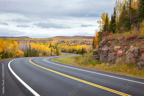 Curving highway and colorful trees in northern Minnesota on a autumn day