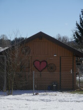 The Wooden House With Painted Hearts On It