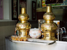 Traditional Chinese Drink In A Golden Jars