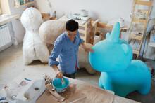 Master With Wonderful Papier-mache Statues
