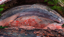 Panorama Of Prehistoric Paintings On A Cliff In The Northeast Of The Country In Ubon Ratchathani ,Thailand. Sandstone Texture And Ancient Painting In Pha Taem National Park.