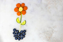 Flower Made Out Of Vegetables And Berries On White Background