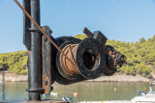 Rusty port winch on the port assos in greece Canvas