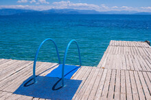 View Of Wooden Pier With Blue ...