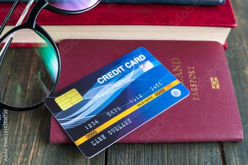 Fototapeta Credit card put on passport on wooden desk obraz