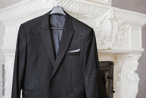 Fotografie, Obraz A groom suit hang at home on wedding day