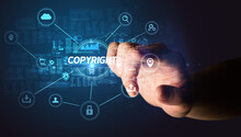 Hand Touching COPYRIGHT Inscription, Cybersecurity Concept