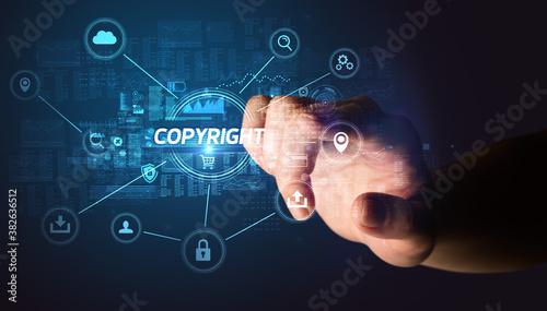 Fotografia, Obraz Hand touching COPYRIGHT inscription, Cybersecurity concept