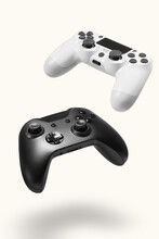 White And Black Game Controllers On White Background