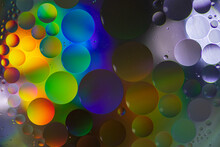 Oil Drops In The Water Create An Artistic And Imaginatively Designed Abstract Background