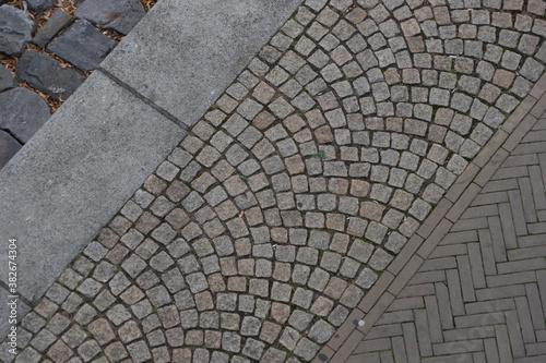 Cuadros en Lienzo Background construction of cobblestone and herringbone pattern at the sidewalk