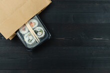 Sushi Tray In Paper Bag On Bla...