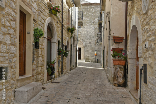 Fototapety, obrazy: A narrow street among the old houses of Ferrazzano, a medieval village in the Molise region.