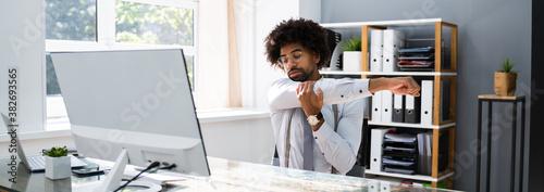 Black Man Stretching At Office Desk Canvas Print