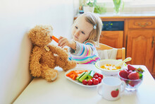 Adorable Toddler Girl Eating F...