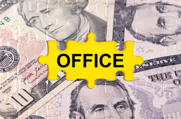 Puzzle with the image of dollars in the center of the inscription -OFFICE