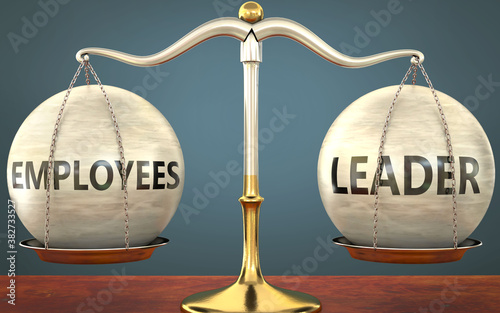Photo employees and leader staying in balance - pictured as a metal scale with weights