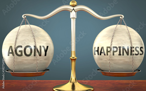 Fotografía agony and happiness staying in balance - pictured as a metal scale with weights