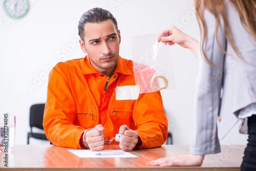 Young man meeting with advocate in pre-trial detention Canvas Print