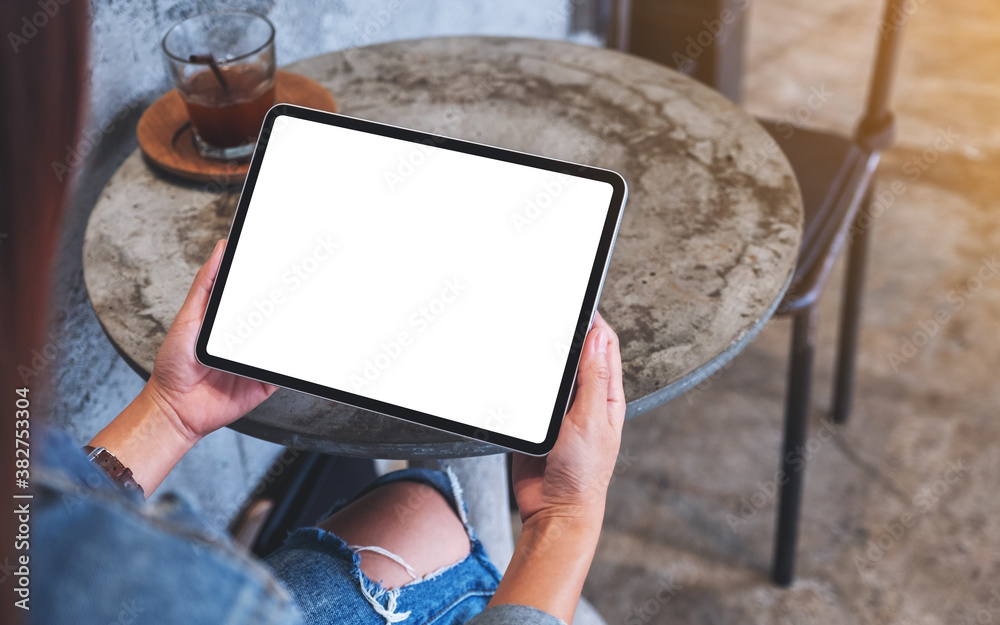 Fototapeta Top view mockup image of a woman holding digital tablet with blank white desktop screen
