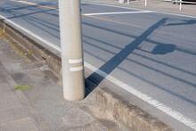 Shadow Of Utility Pole Reflect...
