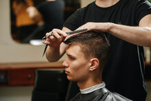 Indifferent Loof Young Man In A Barber Shop Getting A Trim, Close Up.