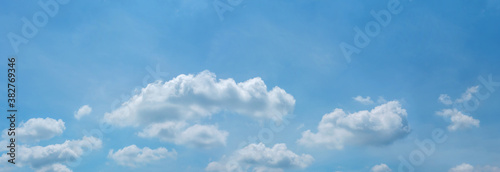 Fototapeta blue sky horizontal with beautiful fluffy cirrocumulus clouds in clear sunny sum