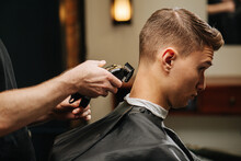 Young Man In A Barber Shop Get...