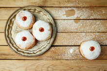 Jewish Holiday Hanukkah Concept With Traditional Donuts Sufganiyah On Wooden Table Background