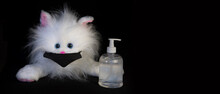 Soft Toy White Cat With Medical Face Mask And Alcohol Sanitizer Gel Hand Wash For Covid-19. Coronavirus Prevention Concept. Black Background