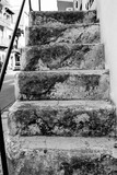 Fototapeta Na drzwi - evocative black and white image of ancient external stone stairs