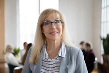 Headshot Portrait Of Smiling Middle-aged Confident Caucasian Businesswoman In Glasses Show Confidence Leadership. Profile Picture Of Happy Successful Female Employee Worker In Spectacles In Office.