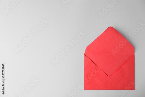 Red paper envelope on light background, top view. Space for text Fototapete