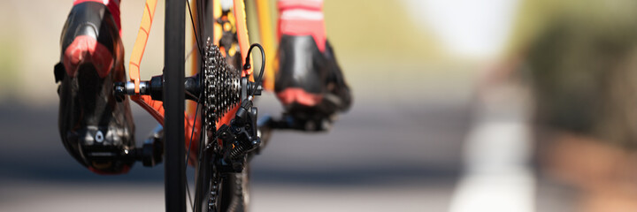 Racing - bike detail on gear wheels and feet