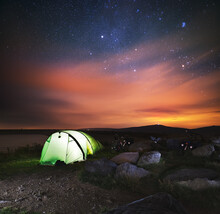 Sleeping Under Starry Sky In Jeseniky Mountains Near Upper Reservoir Of Dlouhe Strane Pumped-storage Hydro Power Station. Camping In Tent In Nature. Jeseniky With Praded Mountain.