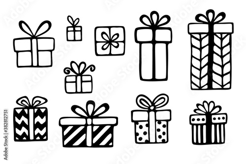 Fototapeta Vector set of hand drawn gift boxes in different wrapping paper and with bowknots