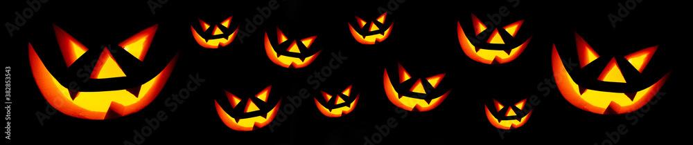 Fototapeta Scary face on black background. Jack-o-lantern in the dark