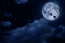 Magic Christmas Eve. Santa With Reindeers Flying In Sky On Full Moon Night