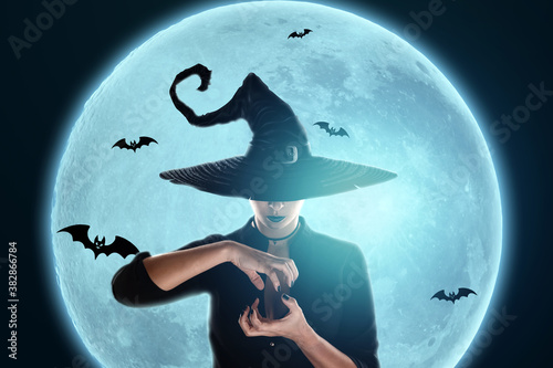 Obraz na plátne Halloween witch girl conjures against the background of the moon