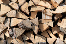 Chopped Firewood Stacked In A Woodpile, View From The End Of The Masonry