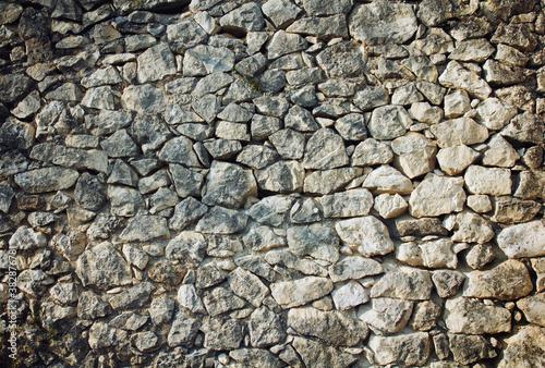 Fotografiet wall of beige natural stones, rubble masonry