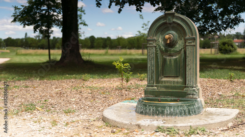 Pretty little fountain in the park to quench thirst of those who stroll Canvas Print