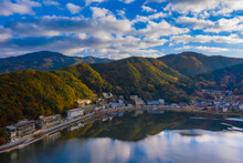 Japan. The Town Of Kawaguchiko. Houses On The Shore Of Lake Kawaguchiko. A City Between A Lake And A Mountain. Mountain Landscape Of Japan. Beautiful Nature Of Japan. Tourist Attraction Of Asia.