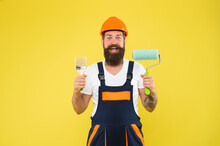 Happy Painter In Working Clothes Hold Paint Roller And Brush Painting Tools For Building And Construction Work, Finishing